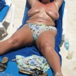 showing my saggy titties off on the beach and spreading my legs .....