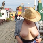 Titties out on the pier, I'm sure that pirate knows I'm flashing!