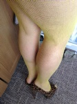 in yellow fishnets and leopard heels