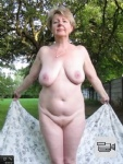 Beautiful Ivana - a natural lady nude and relaxed outside - one more video