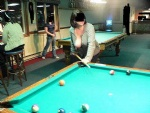 Playing pool. Guys at next table invited us to private room at back of pool...