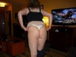 A mature fat ass in thongs
