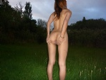 Fully nude in a public place from behind