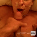 Beth takes a massive load of cum to the face.. then cums as she sucks that ...