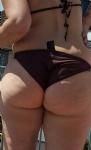 My wife's round ass in bikini